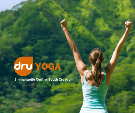 woman practicing dru yoga with arms in the air